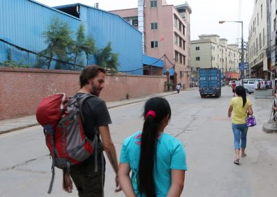 Ben, in China, walking with May.