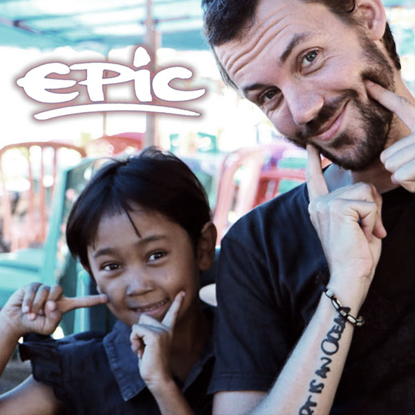 Epic. Ben and a young girl smiling and making a smiling gesture with their fingers.