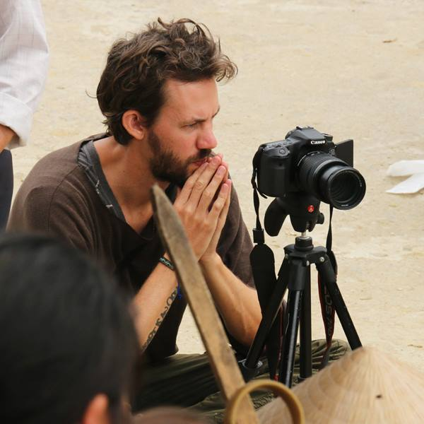 Ben, sitting, filming 'Sisters For Sale'